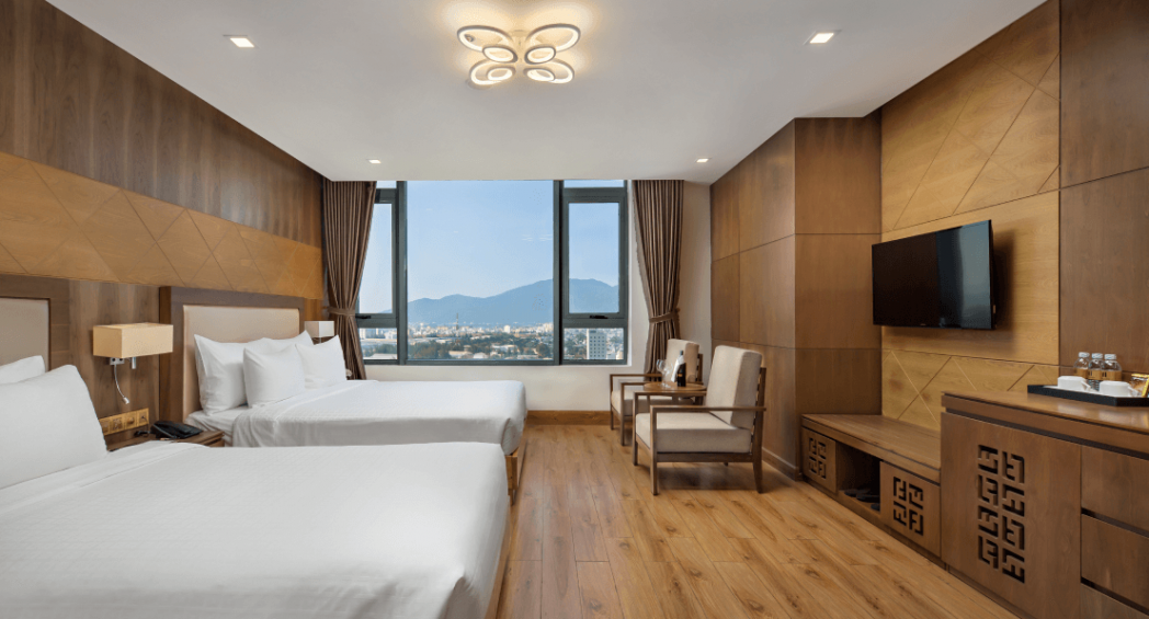 premier deluxe triple room da nang hotel near beach
